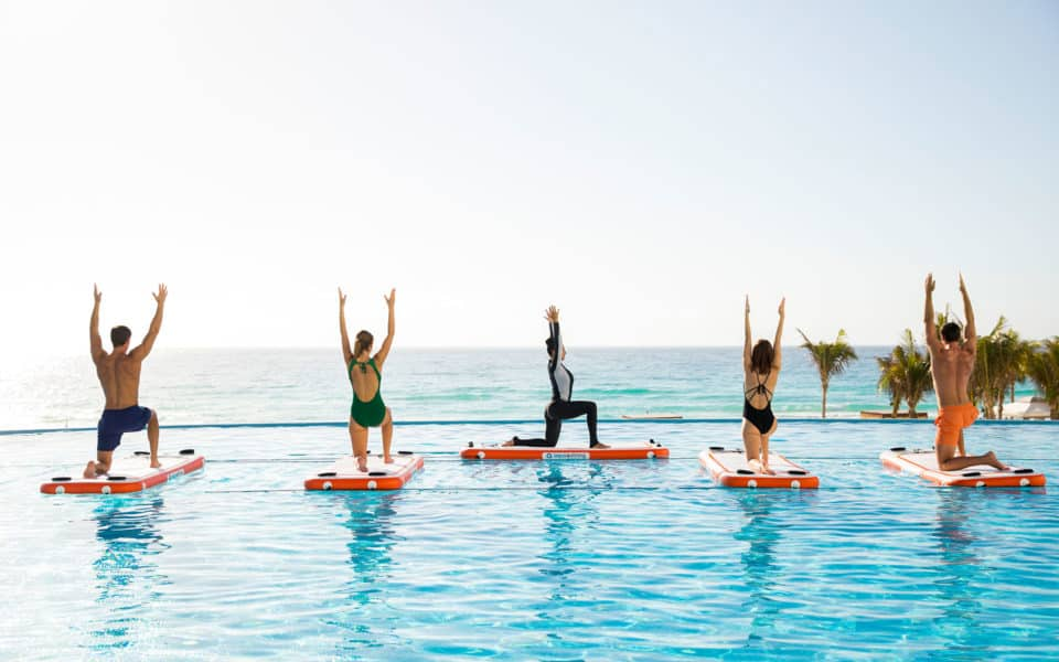 Le-Blanc-Spa-Resort-Yoga-at-Sol-Pool